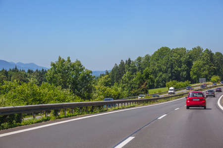 Germany. Summer day. Suburban highway. Car traffic