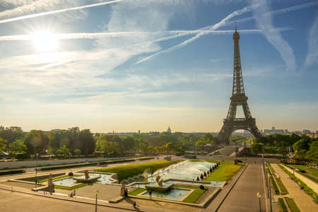 France. Paris. The Eiffel Tower and the fountain in the gardens of the Trocadero. Sunny morning