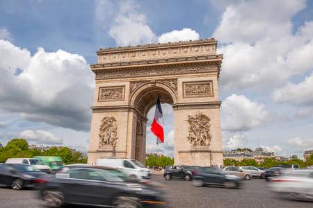 France. Paris. Square around the Arc de Triomphe. Heavy traffic. Clouds run fast