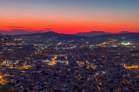 Greece. Panoramic view from a high point on Athens without the Acropolis. Red sunset