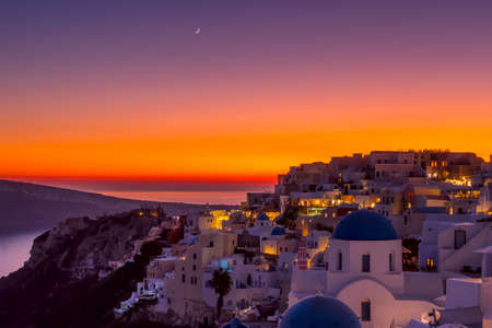Greece. Thira Island. Roofs of Oia during a colorful sunset Banco de Imagens