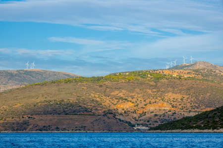 Greece. Gulf of Corinth. Hilly shores with hilltop wind farms. View from the boat 스톡 콘텐츠