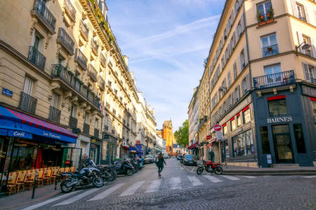 France, Paris. Sunny summer morning in the city center. Street cafe at the crossroads