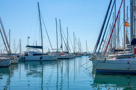 Greece. Sunny summer day. Small greek town. Lots of sailing yachts in a marina