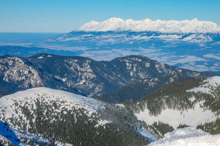 Winter Slovakia. Low Tatras. Snowy peaks in sunny weather and valleys forest