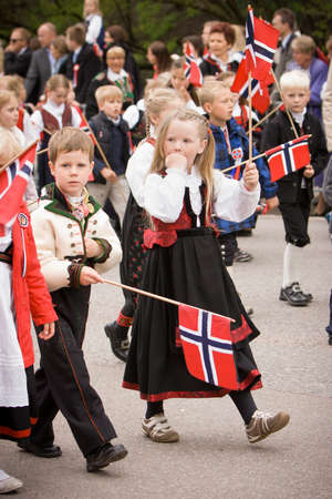 17: OSLO  NORWAY - May 17, 2010: National day in Norway. Norwegians at traditional celebration and parade on Karl Johans Gate street.