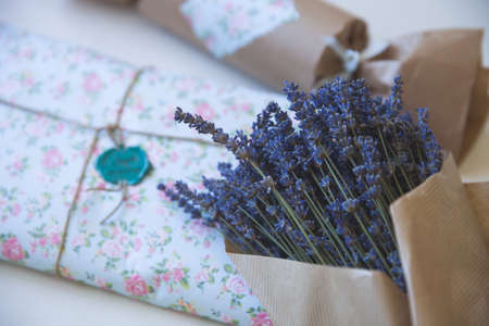 craft paper: Bunch of French lavender in craft paper and nice gift package. Present and flowers.