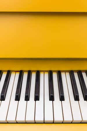 Top view on yellow piano. Closeup of piano keys. Music concept Stock Photo