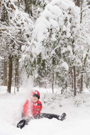 portarit: Portarit of cute preschool kid boy playing with snow in the park. Child having fun on a cold winter day outdoors. Stock Photo