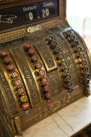 Closeup of an antique style cash register in a shop. Retro cash machine. Imagens