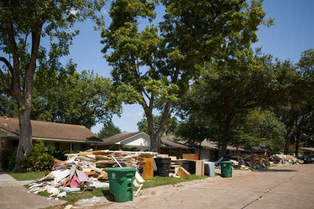 Houston, Texas, USA, September 10 2017: Damaged houses on one of the streets. After hurricane Harvey. Trash and damaged households outside the houses. Editoriali