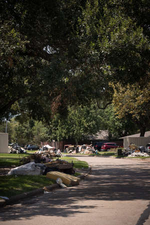 Houston, Texas, USA, September 10 2017: Damaged houses on one of the streets. After hurricane Harvey. Trash and damaged households outside the houses. Editorial