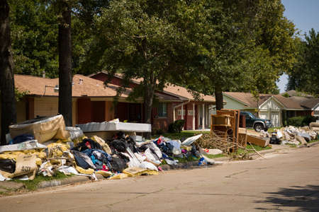 Houston, Texas, USA, September 10, 2017: Consequences from Hurricane Harvey. Flooded, damaged houses on one of the streets. Garbage and damaged things outside the houses. Publikacyjne