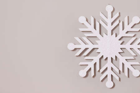 Closeup of white snowflake on wall or background Banco de Imagens