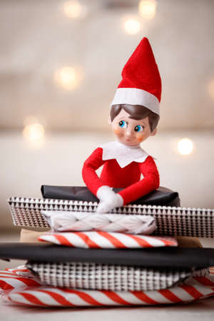 Closeup of Elf with presents for advent calendar on wooden table background. Celebration concept Reklamní fotografie