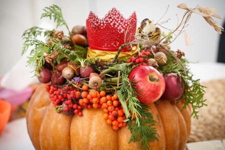 Autumn background of pumpkins, vegetables and fruits. Thanksgiving concept