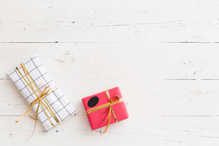 Top view on nice Christmas, birthday or any other celebration presents on white wooden background. Gifts. Holiday season. Stock Photo