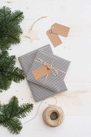 Top view on nice Packing Christmas gifts box on white wooden table or background.