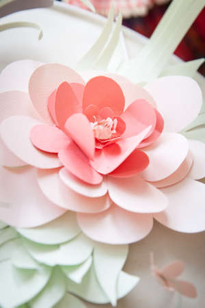 Closeup of paper flower on light background. Handmade flower bud, pastel colors Stock Photo
