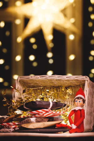 Merry Christmas toy with gifts on the background of garlands and a large Christmas star. Festive season. Stock Photo