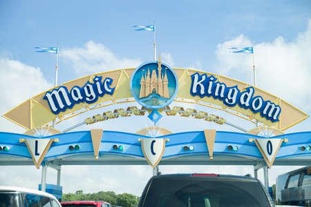 Florida, USA, May 23, 2013: Gates to the world of magic in Disney Park by Magic Kingdom. Many cars with parents and children waiting in line to get to Disney Park in Orlando.