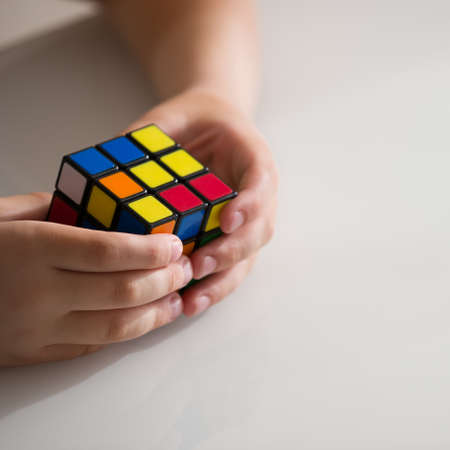 Moscow, Russia, August 16 2017: closeup of Rubick's cube in Child hands.