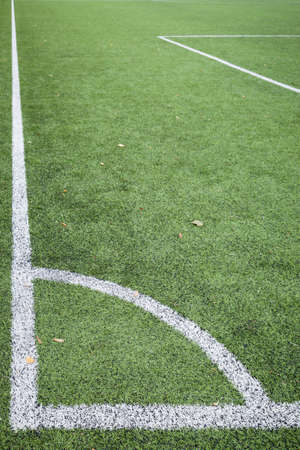 Closeup of Corner kick line of football and soccer field, background texture