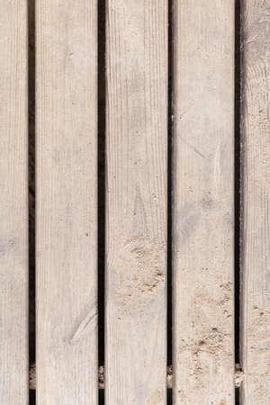 Top view on wooden boards. Floor or bridge made of wood. Walkway in the summer park.