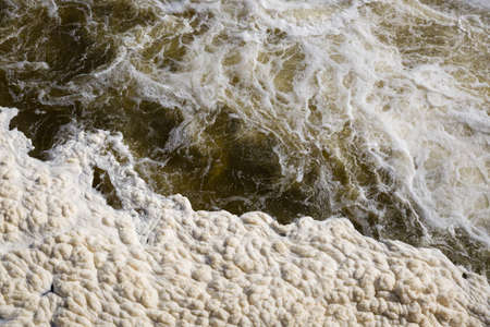 Water drains from the tank, forming columns of water vapor and foam. Top view of bubbling water and foam accumulated after passing through a dam of a hydroelectric power station. 写真素材