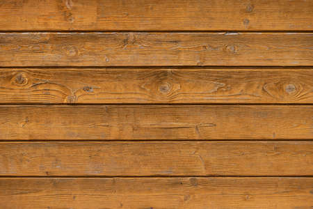 Closeup of texture of weathered varnished wooden wall. Aged wooden plank fence. Copy space