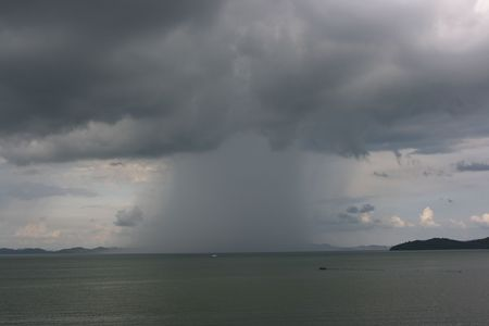 downpour: Downpour in the sea seen from a coast Stock Photo