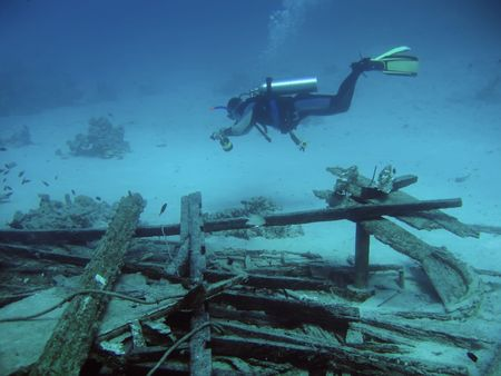unexpectedness: diver in deep and wreck of ship Stock Photo