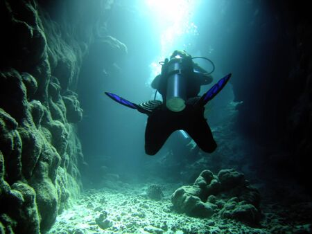 diver in the cave and sunlight photo