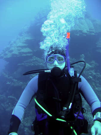 diver in deep and bubble photo