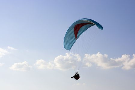 cian: Paraglider with cian wing in the sky Stock Photo