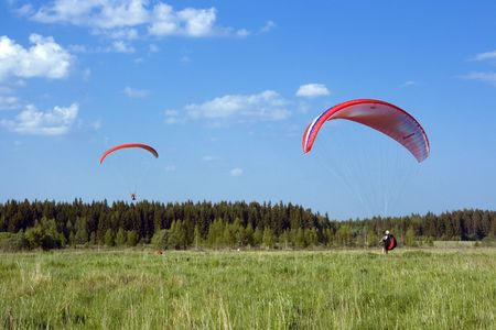 windflower: Two paragliders with red wings
