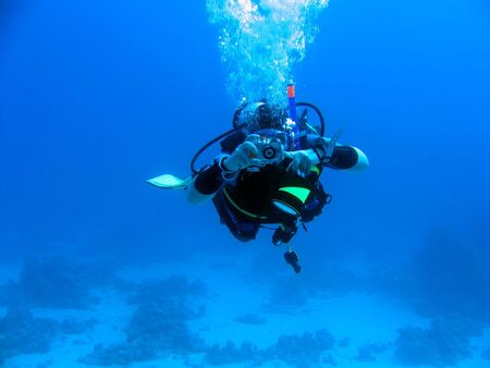 boldness: diver in deep. underwater photographer Stock Photo