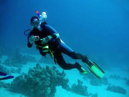 diver: diver with camera in deep. underwater photographer Stock Photo