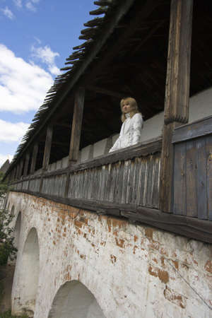 The girl on an ancient fortification waits for returning favourite with war Stock Photo - 2175262