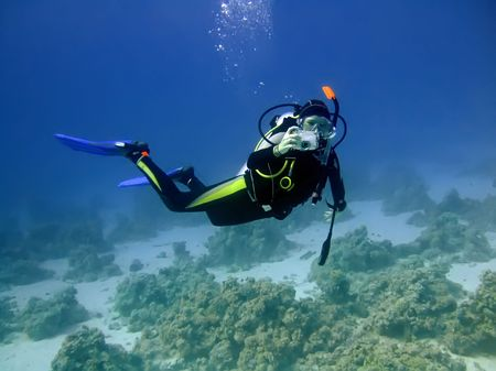 diver: Diver with camera in deep and bubbles. Underwater photographer Stock Photo