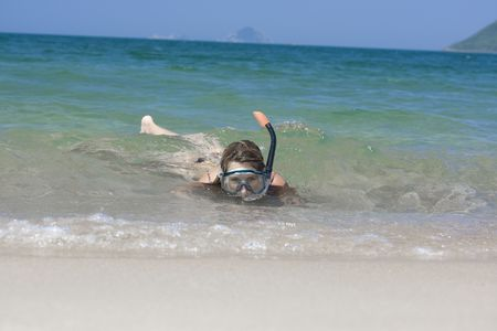Young woman snorkeling in the tropical sea. Stock Photo - 3112615