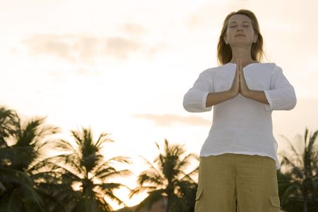Young woman doing yoga exercises on sunset time Stock Photo - 3306051