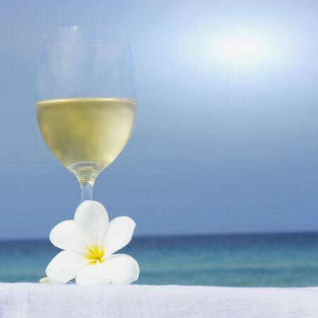 beach drink: Glass of white wine on tropical beach