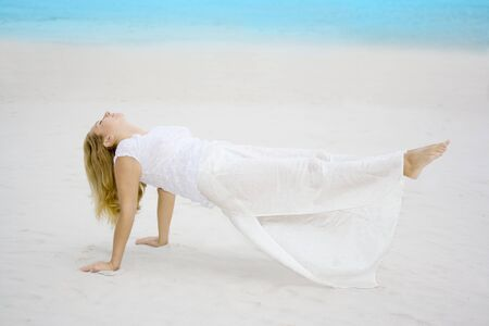 Woman meditating near ocean. Feet out of earth Stock Photo - 4149170