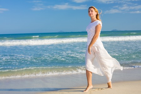Young woman dancing near the ocean. Stock Photo - 4252140