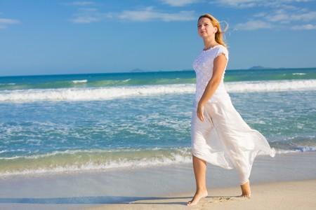 Young woman dancing near the ocean. Stock Photo - 4252140