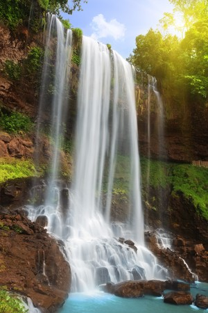 Waterfall in rain forest photo