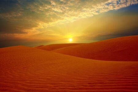 Sandy desert at sunset time photo