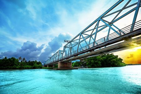 Railway bridge over the river at sunset time. Vietnam. Nha Trang