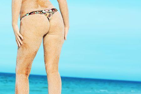 beautiful woman body over sea background photo